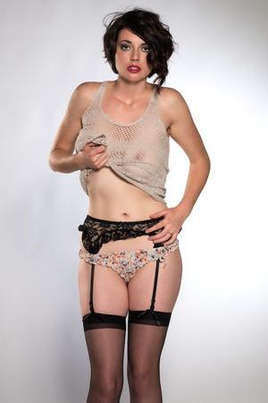 garters: Beautiful tall brunette in a revealing knit top