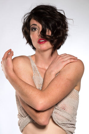 Beautiful tall brunette in a revealing knit top