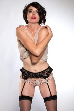 revealing: Beautiful tall brunette in a revealing knit top