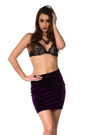 statuesque: Statuesque brunette in a bra and skirt