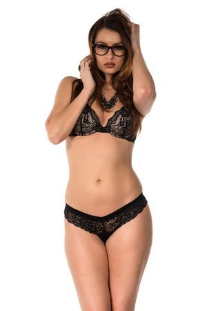 statuesque: Statuesque brunette in black lingerie on white Stock Photo