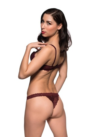 undergarment: Pretty young brunette dressed in purple lingerie