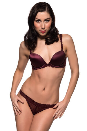 Pretty young brunette dressed in purple lingerie photo