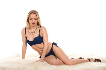 Beautiful young Hungarian blonde in blue and black lingerie