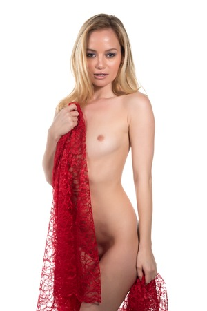 Beautiful nude blonde woman wrapped in red cloth