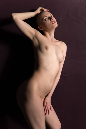 adult nudity: Pretty pale woman with a shaved head Stock Photo