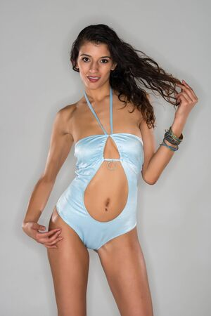 powder blue: Tall slender brunette in a powder blue swimsuit