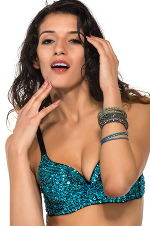 sequined: Tall slender brunette in a sequined blue bra Stock Photo