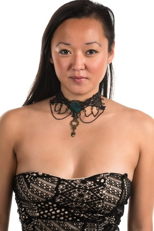 Closeup on a pretty Korean woman with bare shoulders photo