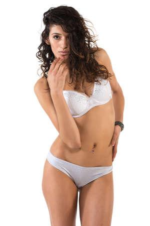 undergarment: Tall slender brunette dressed in white lingerie