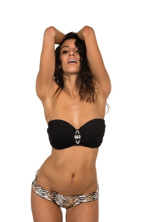 leopard print lingerie: Tall slender brunette in a black bandeau top and leopard print panties
