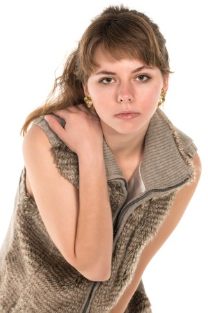 Pretty young brunette in sleeveless fur top