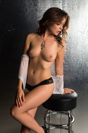 Pretty young topless brunette in black panties Stock Photo