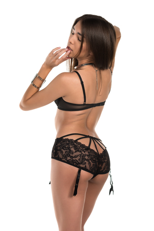 garters: Beautiful petite Eurasian woman in revealing black lingerie