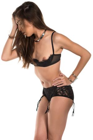 undergarment: Beautiful petite Eurasian woman in revealing black lingerie