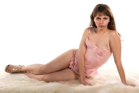 corset: Pretty young brunette in a pink corset