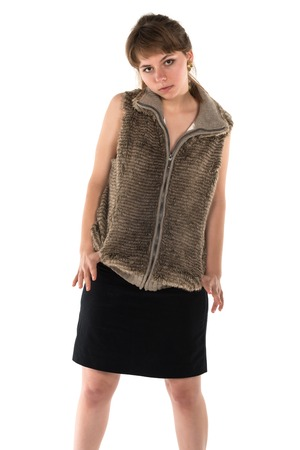 Pretty young brunette in sleeveless fur top and black skirt Banco de Imagens