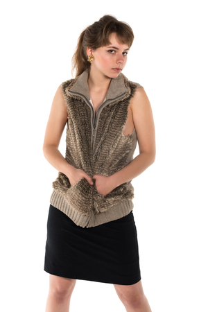 sleeveless top: Pretty young brunette in sleeveless fur top and black skirt Stock Photo