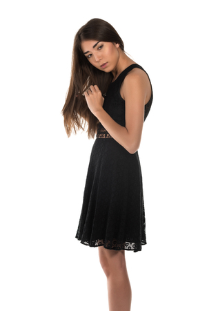 Beautiful petite Eurasian woman in a black lace dress