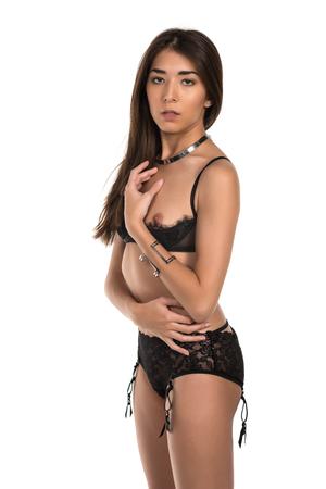 revealing: Beautiful petite Eurasian woman in revealing black lingerie