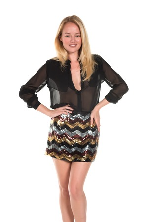 Beautiful young Hungarian blonde in a brown blouse and sequined skirt Imagens - 38559237