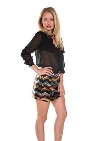 Beautiful young Hungarian blonde in a brown blouse and sequined skirt Imagens