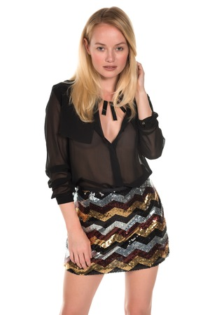 sequined: Beautiful young Hungarian blonde in a brown blouse and sequined skirt Stock Photo