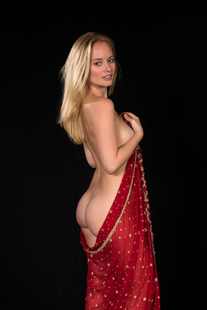 Beautiful young nude Hungarian blonde wrapped in a South Asian scarf Imagens