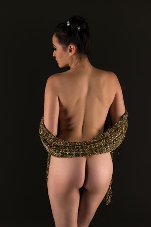 sexy asian woman: Beautiful nude multiracial woman wrapped in gold fabric Stock Photo