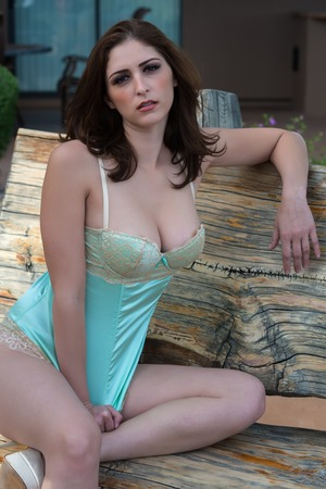 camisole: Beautiful young brunette in a teal camisole Stock Photo