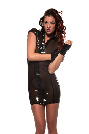 highlights: Tall slim brunette with red highlights in a brown latex dress