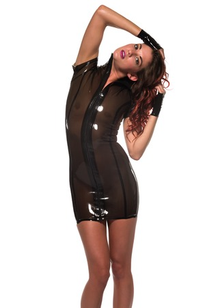 latex fetish: Tall slim brunette with red highlights in a brown latex dress