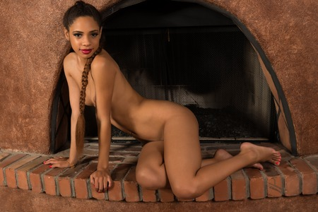 naked african: Beautiful young multiracial woman nude in a fireplace