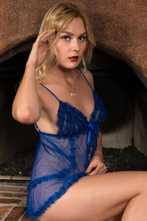 chemise: Beautiful tall Russian blonde in a blue chemise