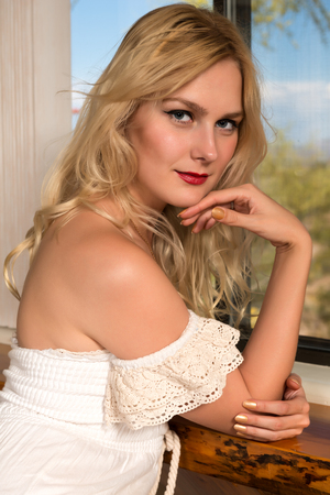 strapless: Beautiful tall Russian blonde in a long dress Stock Photo