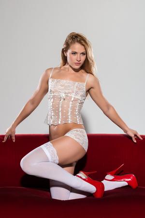 Pretty petite blonde in white lingerie