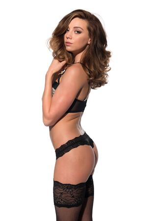 panty hose: Beautiful young brunette in black and gold lingerie