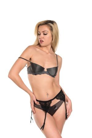 garter belt: Beautiful tall Russian blonde in gray lingerie Stock Photo