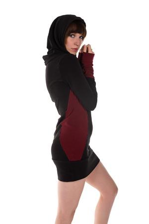 cowl: Pretty slender brunette in a hooded dress