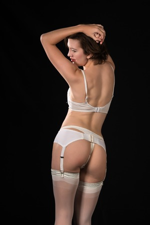 garter belt: Pretty young brunette in vintage white underwear