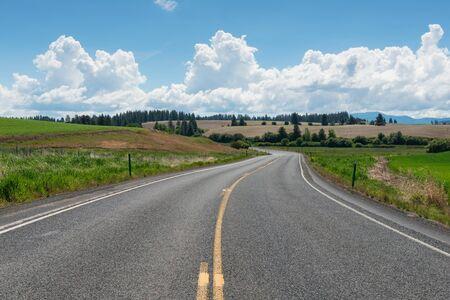 curving: Road curving through rolling hills near Potlatch, Idaho