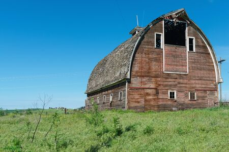 colfax: Old wooden barn on a hill, Colfax, Washington Editorial