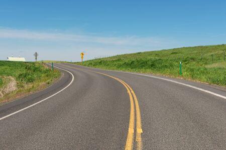 idaho: Road curving through rolling hills near Potlatch, Idaho