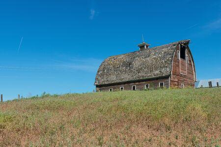 colfax: Old wooden barn on a hill, Colfax, Washington Stock Photo