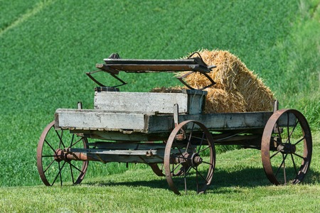palouse: Old horse-drawn wagon with bales of hay, Palouse, Washington Stock Photo