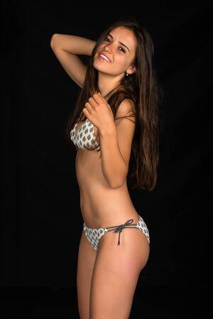 bikini slender: Slender young Romanian woman in a beige bikini