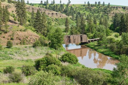 Covered bridge over a muddy creek, Harpole, Washington Stock Photo