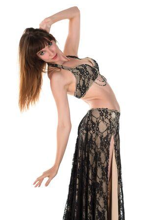 dance costume: Tall slim brunette in a black belly dance costume