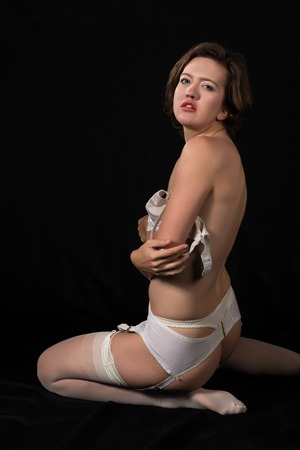 panty hose: Pretty young brunette in vintage white underwear