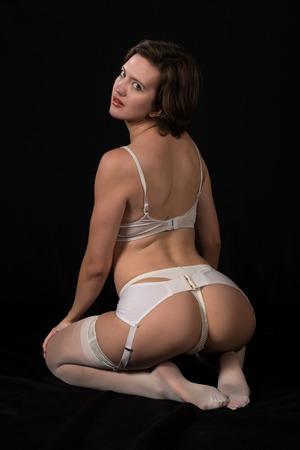 undergarment: Pretty young brunette in vintage white underwear